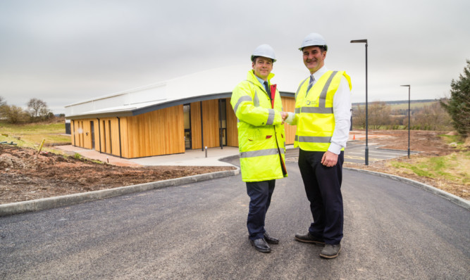 School bursar Anthony Glasgow and project manager Stevie White outside the new studio.