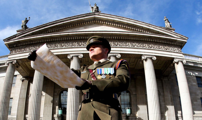 Captain Peter Kelleher from the 27th Infantry Battalion reads the Proclamation at the GPO on OConnell Street, Dublin,4 yesterday during the commemoration of the Easter Rising of 1916.