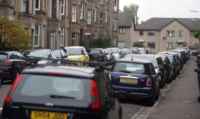 Cars parked in Bellfield Avenue.