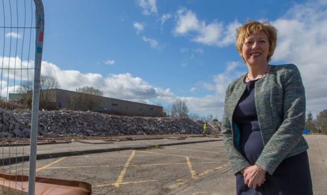 Councillor Laird at the site of the former Havelock Building, which has now been cleared.