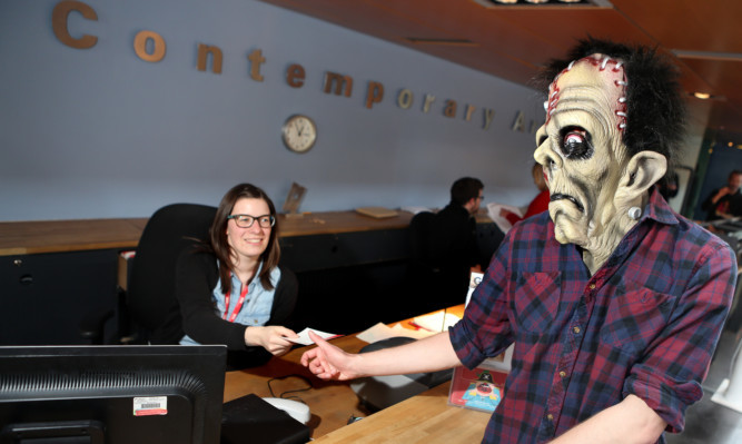 Frankenstein's monster buying tickets for one of the screenings from Chloe Milne.