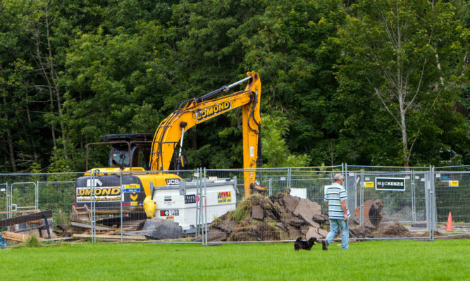 Part of the defences has been unearthed after a row over the land.