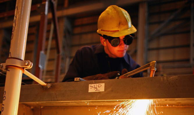 An apprentice steel fabricator learns his trade. The TUC said that if the Government wants to attract more young people into apprenticeships, it needs to up the £3.40 rate.
