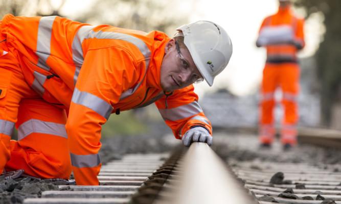 On track: an SSE Enterprise Rail engineer checks a line.