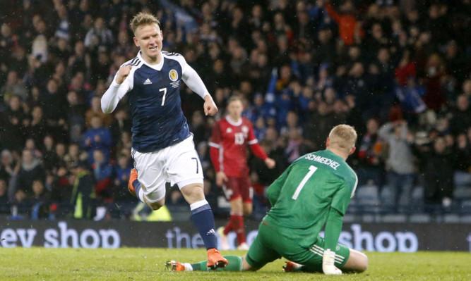 Matt Ritchie celebrates scoring for Scotland.