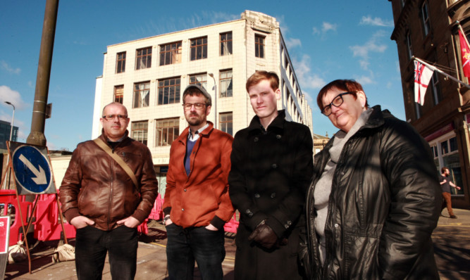 From left:, Ian McKay, Phil Doig, Neil Morrison, Pam Turner who are opposed to the demolition of the former Robertson's furniture store.