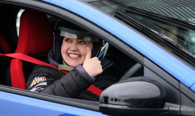 Scottish Conservative leader Ruth Davidson sits in a blue car at Knockhill racing circuit.