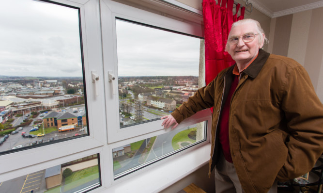Raeburn Heights resident Danny Murphy shows off the view from his 13th floor flat in Glenrothes.