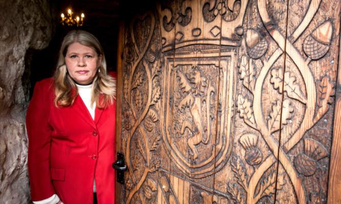 Kelly Morris at the door of Balgonie Castle