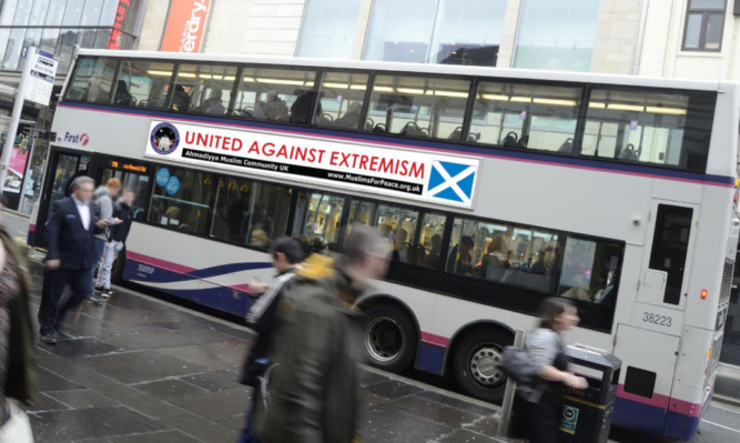 The Ahmadiyya Muslim Community has decorated buses with anti-extremism messages.