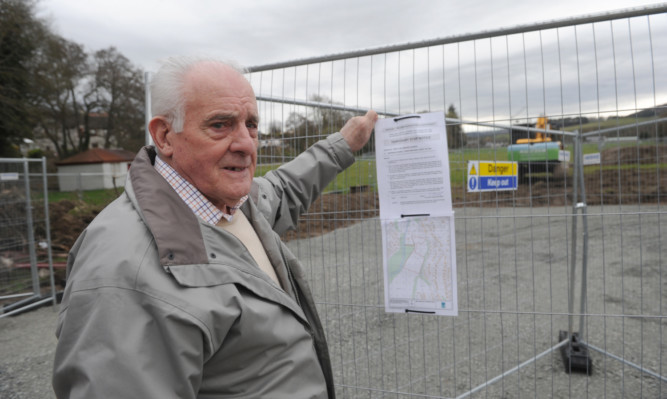 Local resident Douglas Gorrie stands next to the Morrisons Academy Dallerie playing fields where work has started too early and a temporary stop notice has been posted.