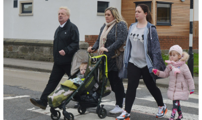 From left: Councillor John OBrien, Jackie Brown and Shannon Baxter with children Ryan and Indie on the crossing outside Woodlands Nursery Centre.