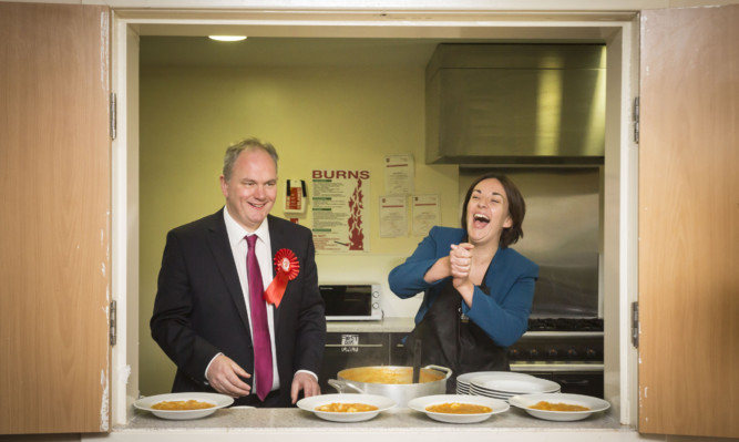 Scottish Labour leader Kezia Dugdale and Paul Martin, Labour candidate for Glasgow Provan, serve soup during their visit to Daffodil pensioners club.