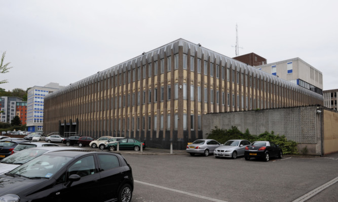 Higgins admitted behaving in a threatening or abusive manner at police headquarters in Dundee.