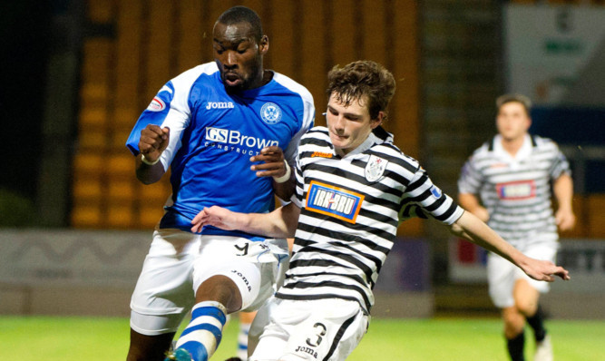 Andrew Robertson up against St Johnstones Gregory Tade in a league cup tie at McDiarmid Park.