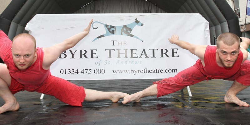 Kris Miller, Courier, 30/07/10, News. Picture today at Market Street, St Andrews. Inside Out, Street Theatre was on in St Andrews today with various shows on the stage in Market Street as well as around the streets. Pic shows Smallpetitklein Dance Co, Allan McIntyre (left) and Matt Lackford who were one of the acts who performed a segment of 'Still' which they performed the Fringe.