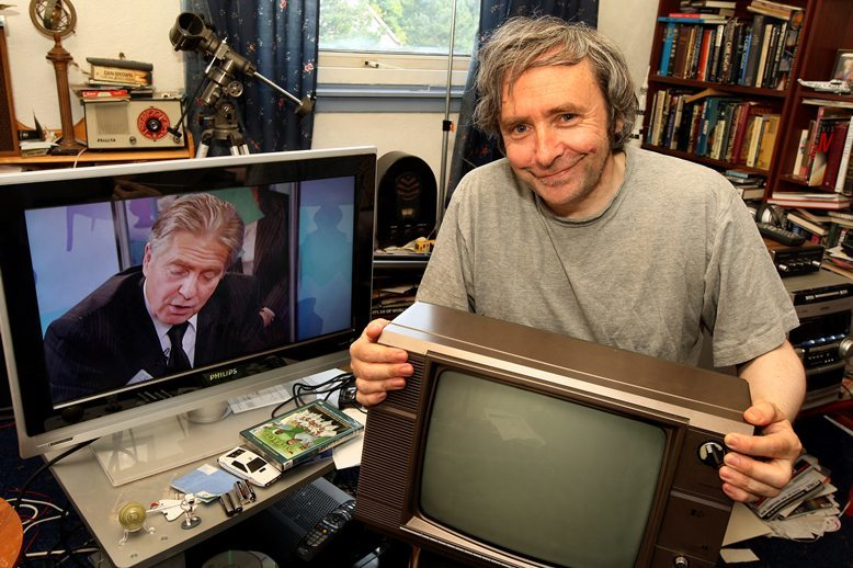 John Stevenson, Courier,03/08/10.Dundee.Digital switchover.Pic shows Robert Law(Burnside Court) with two vastly differing Televisions,on the left a new  flatscreen digital and on the right an analogue TV from the 1970's.