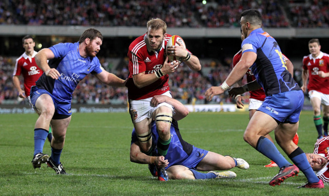 British and Irish Lions' Tom Croft (centre) is tackled by Western Force's Chris Tuatara-Morrison (right) and James Hilterbrand (left).