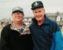 Mr Roy, left, with US President George H.W Bush.