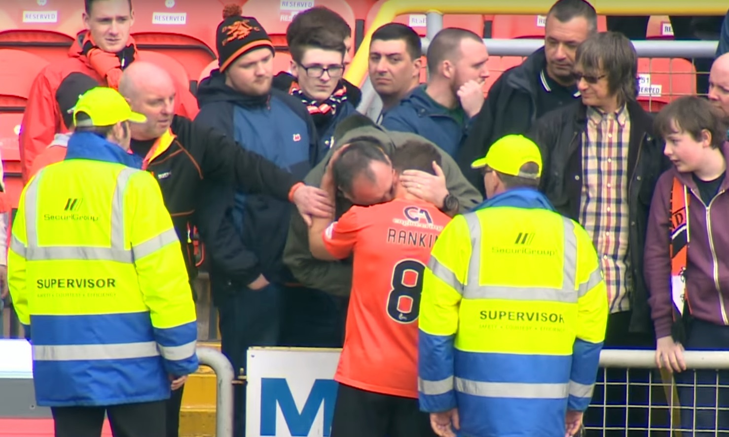 John Rankin being consoled by a fan after the defeat to Hamilton.