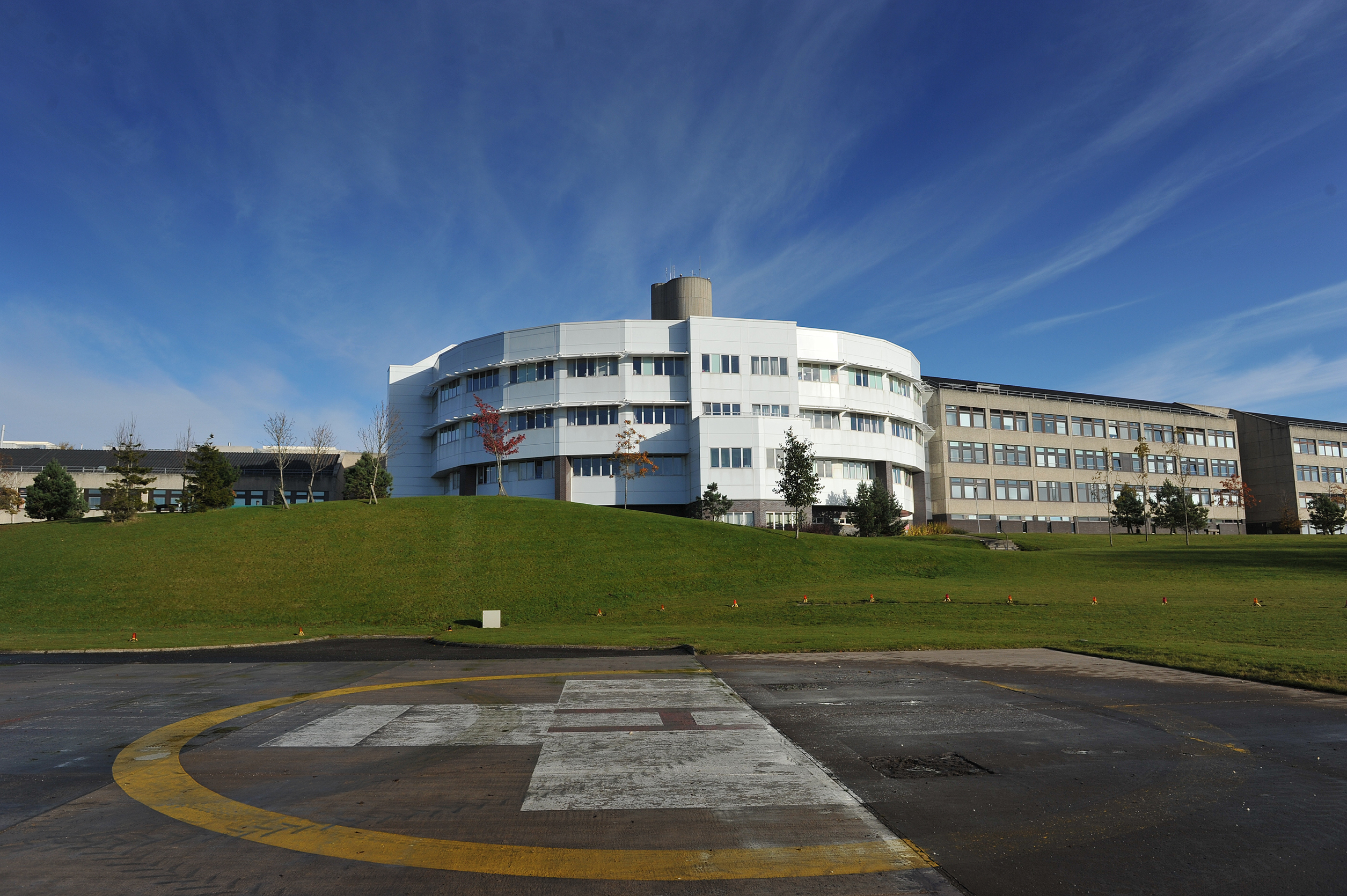 Building exterior of Ninewells Hospital, Dundee, showing the helipad in foreground.