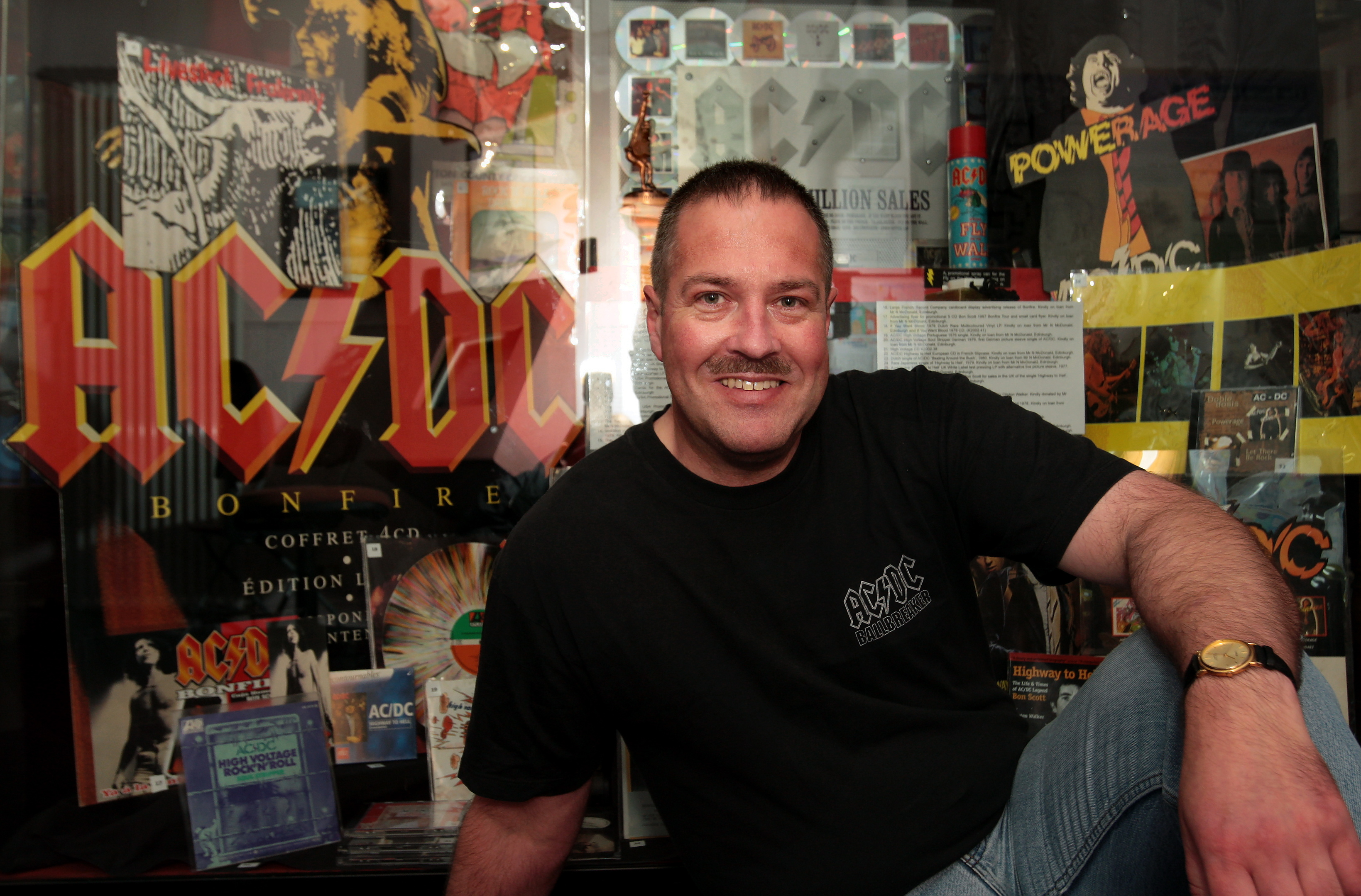 Neil McDonald with some of his collection of AC/DC memorabilia