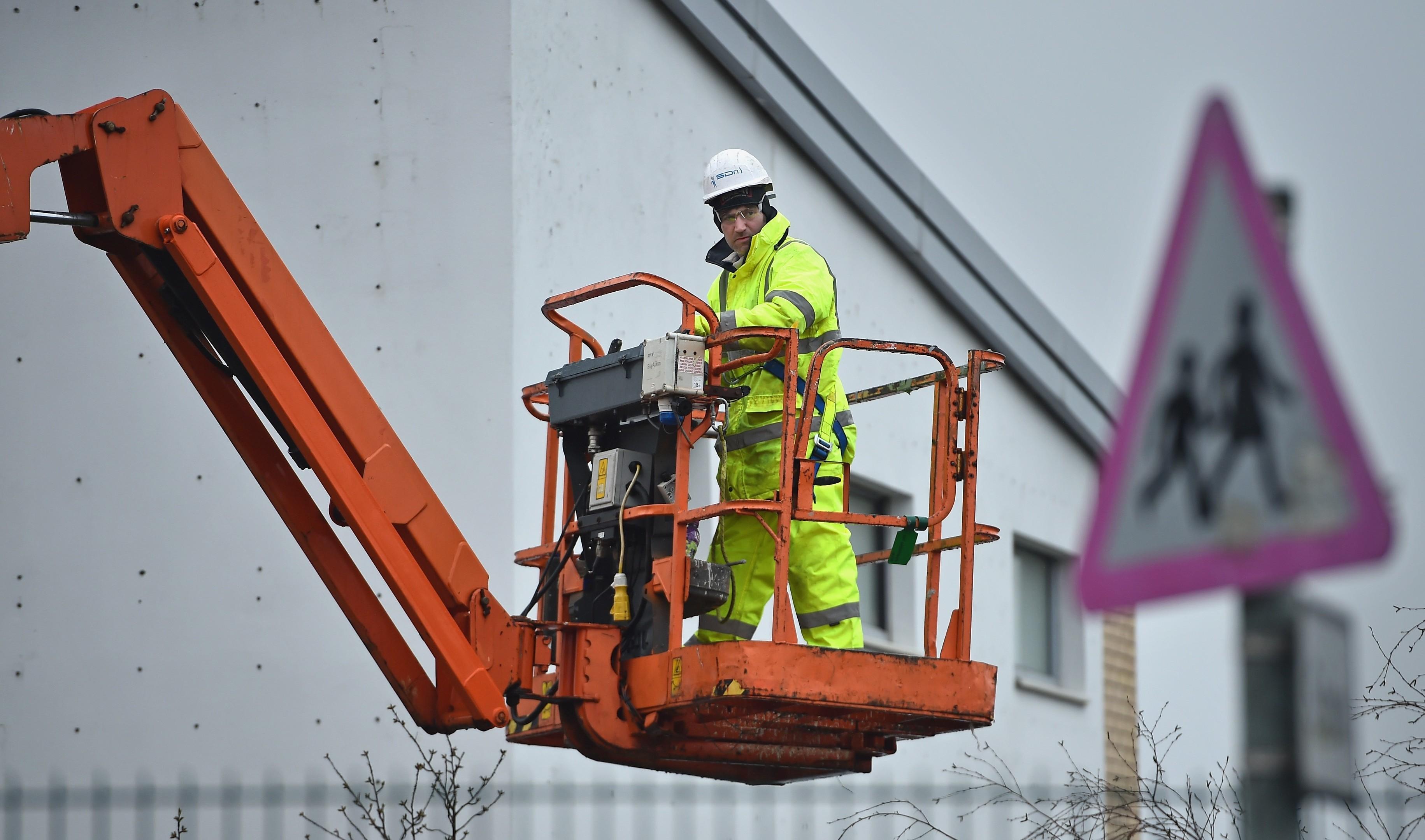 Workmen carry out repairs at Oxgangs Primary School in Edinburgh.