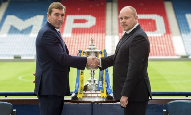 Alan Stubbs (left) shakes hands with Mixu Paatelainen ahead of the big game.