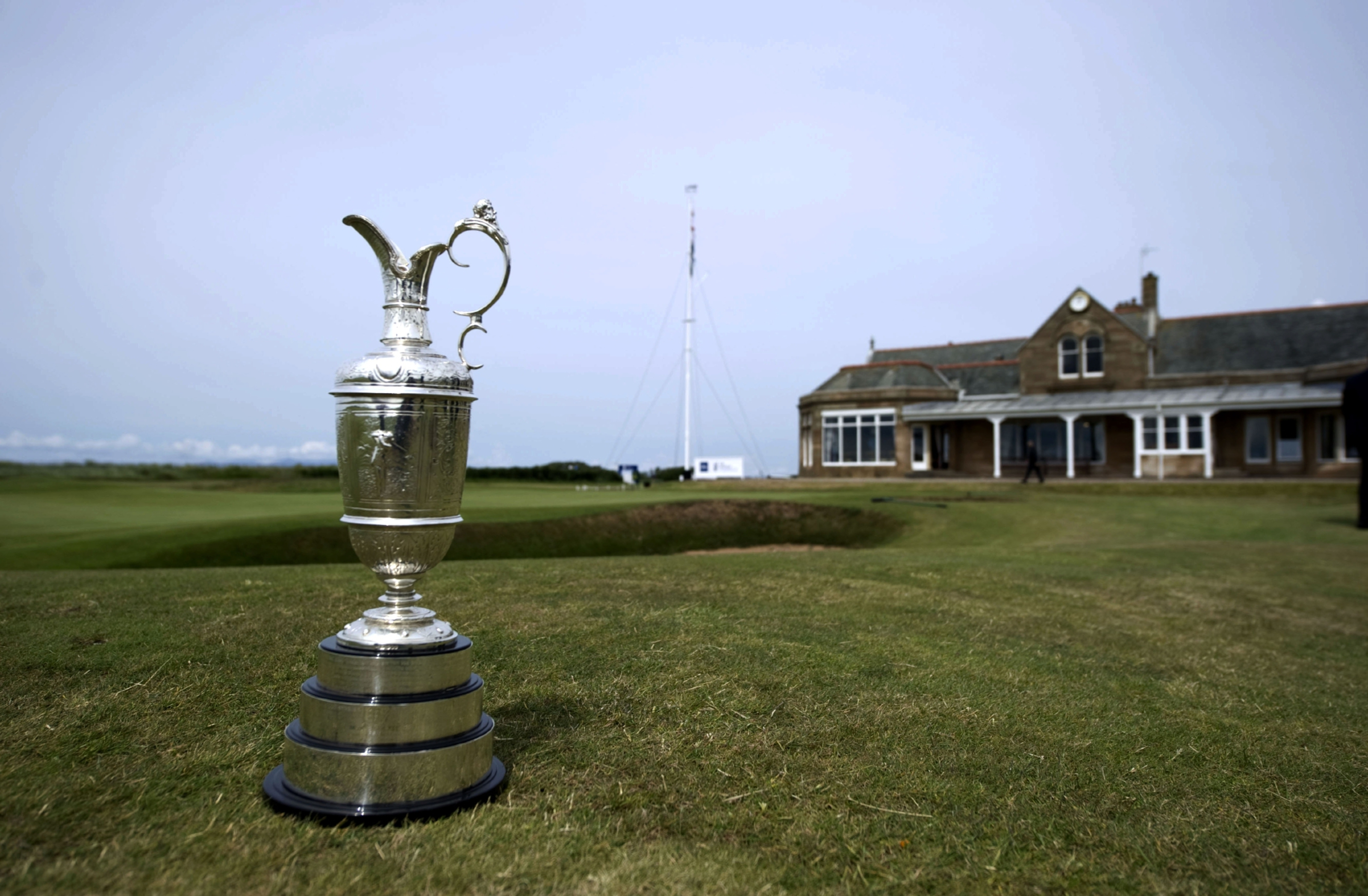 Royal Troon Golf Club with the Claret Jug.