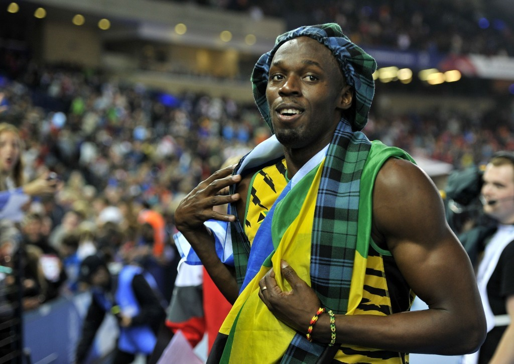 Usain Bolt wears tartan as he celebrates winning the Men's 4x100m Relay at Hampden Park, during Glasgow 2014.Commonwealth Games in Glasgow.