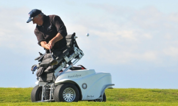 Double amputee Vietnam War veteran Jim Martinson in action on the St Andrews Old Course.
