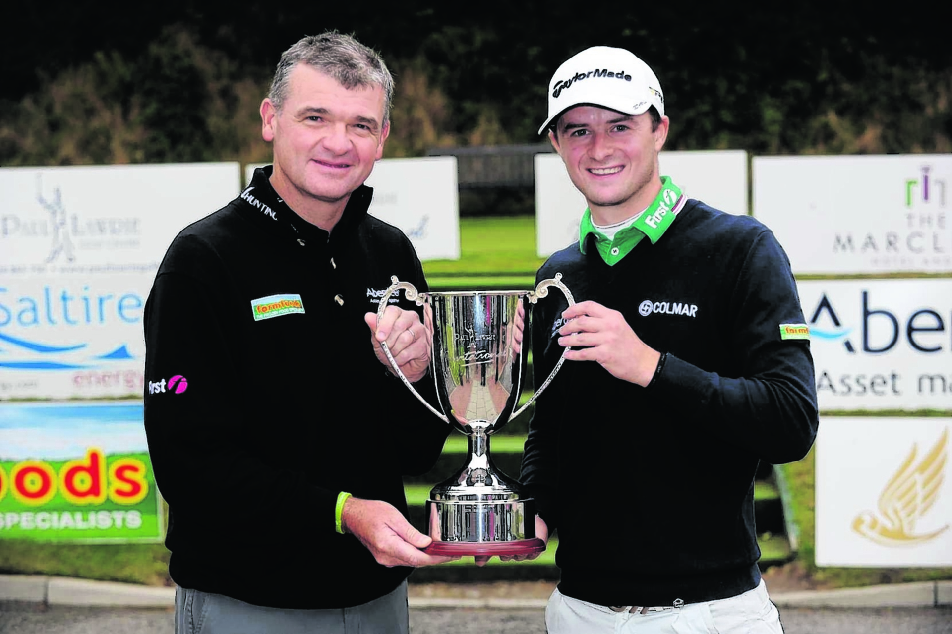 David Law (right) with mentor Paul Lawrie.