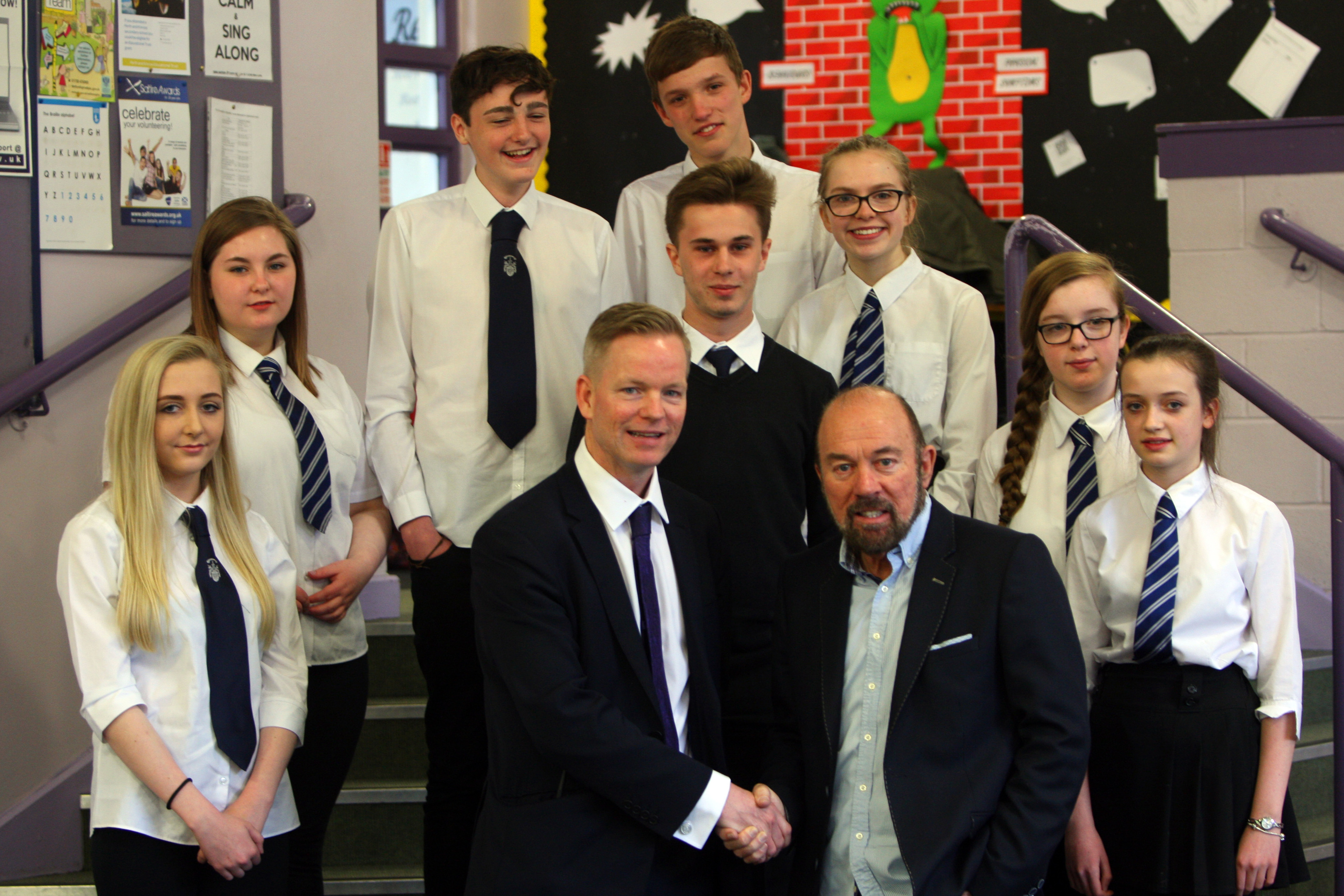 Sir Brian Souter with Perth Academy pupils.