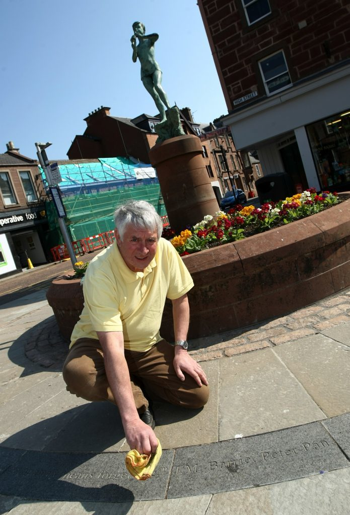 COURIER, DOUGIE NICOLSON, 10/05/16, NEWS. PETER PAN MIS-QUOTE, KIRRIEMUIR. Pic shows David Orr beside the quotation today, Tuesday 10th May 2016, that is laid in the slabs, but is not a quote from Peter Pan, but the Disney film 'Hook' trying a bit of 'Disney' magic and rub it out Story by Angus office.