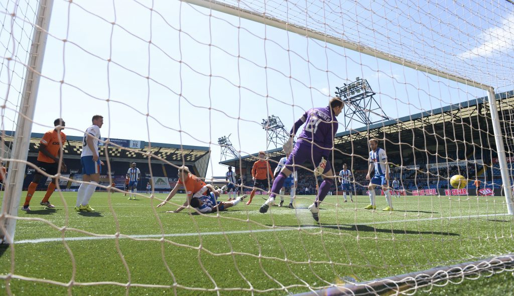 Harry Souttar (centre) heads home Dundee Utd's fourth goal at Kilmarnock.