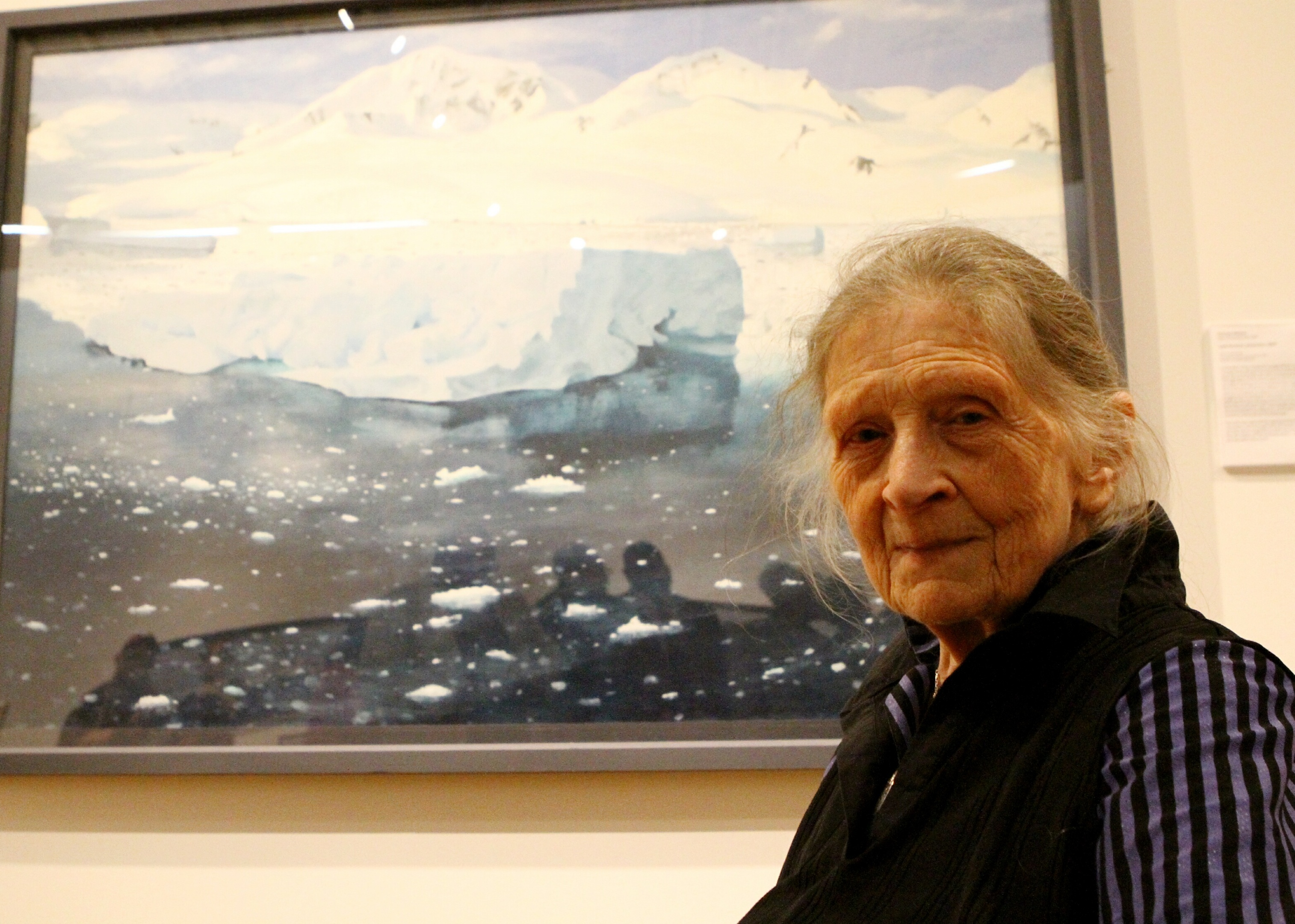 Frances Walker beside one of her paintings in the exhibition.