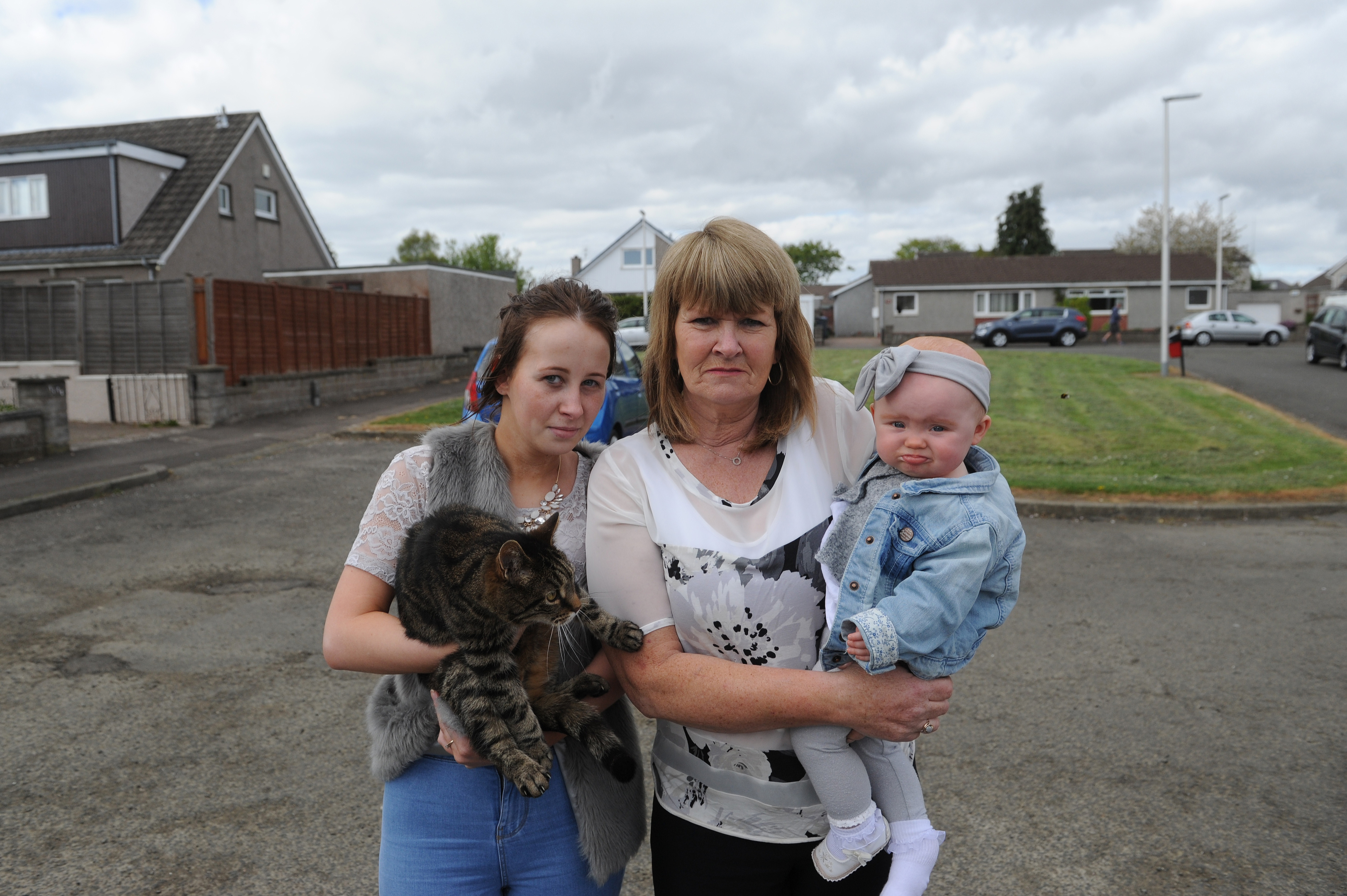 Unhappy with the prospect of a house being built on what they believe is public land are l to r - Rebecca Wood and Laura Black with her grand daughter Harper.