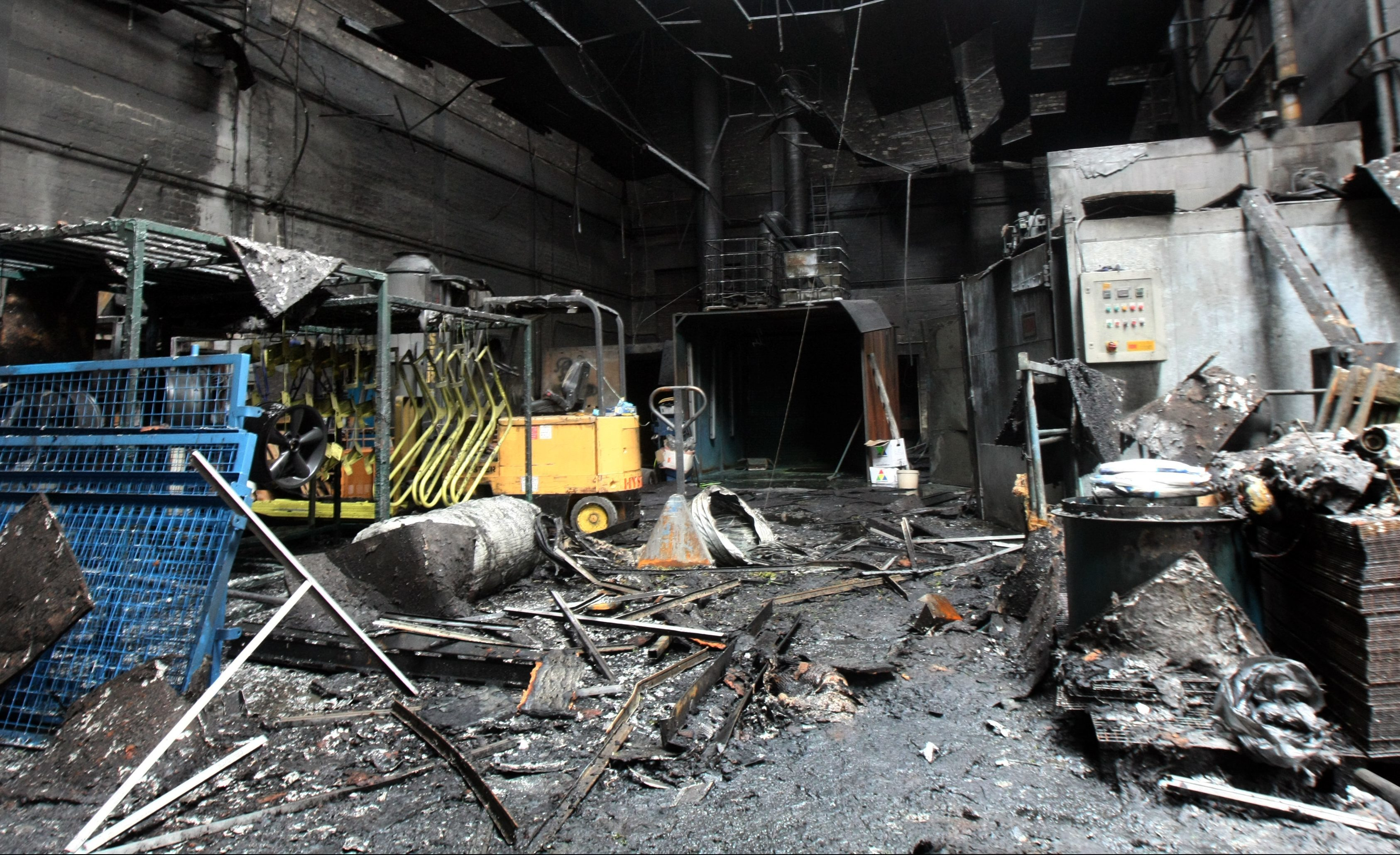 The fire-damaged unit.
