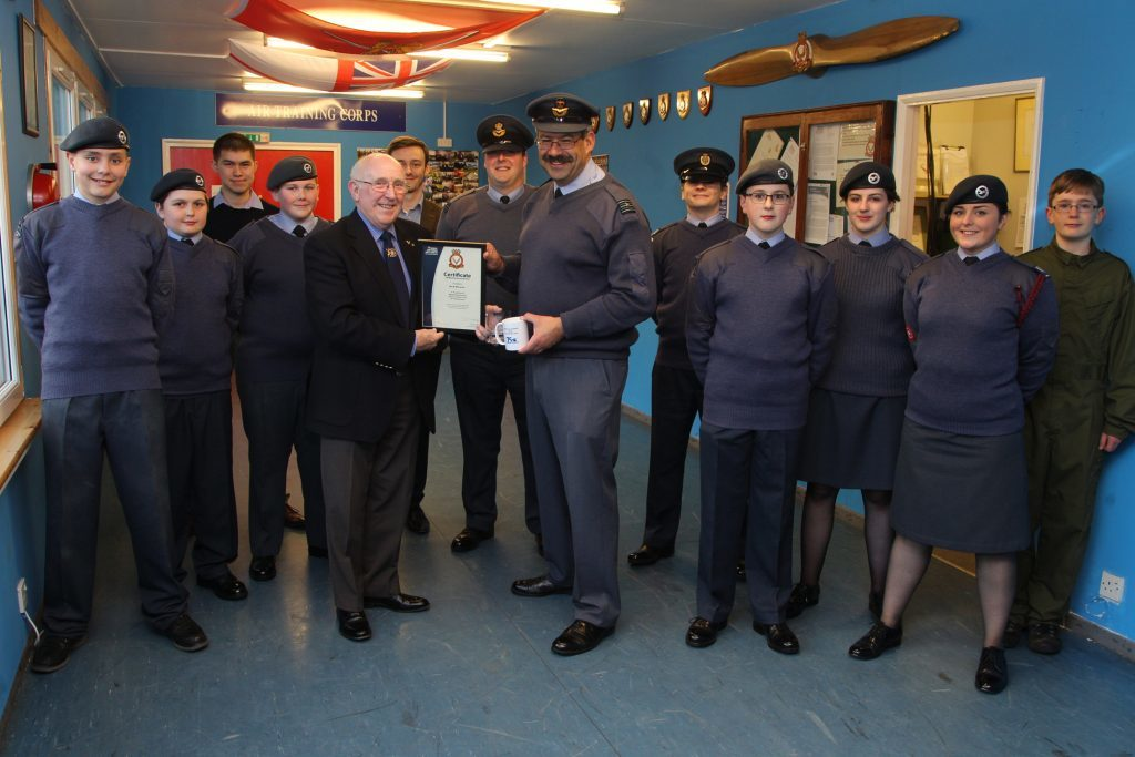 Forfar ATC present an award to Forfar baker Bill McLaren, of the famous town firm, for his stalwart support to 2231 Squadron over many years. Pic shows Wing Commander Kelvin Martin presenting Bill McLaren with the award..pic Paul Reid