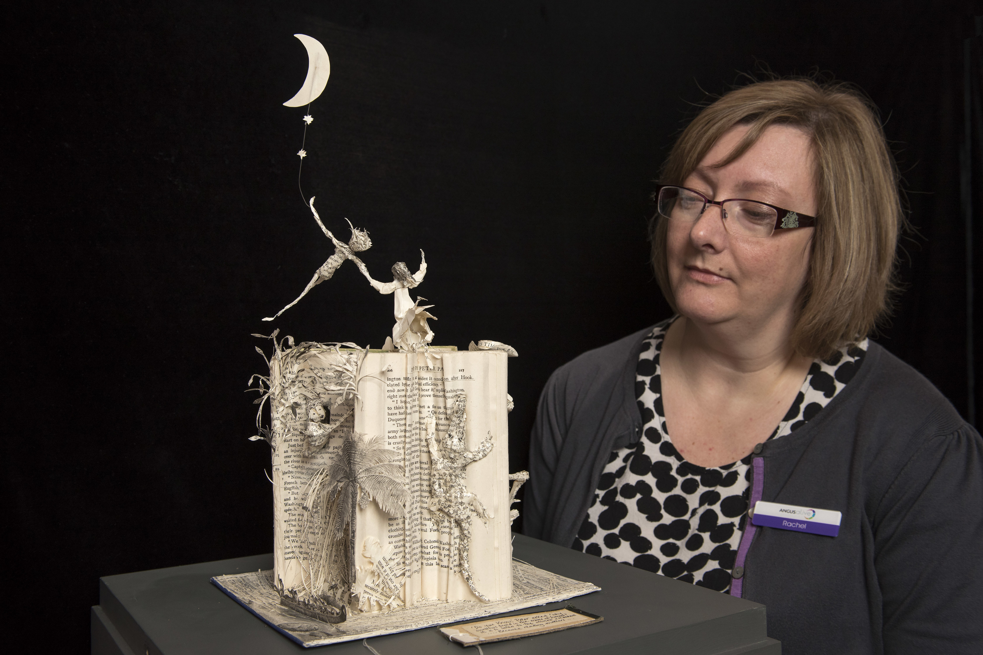 Rachel Jackson with the Peter Pan book sculpture now on loan to the Gateway to the Glens Museum.