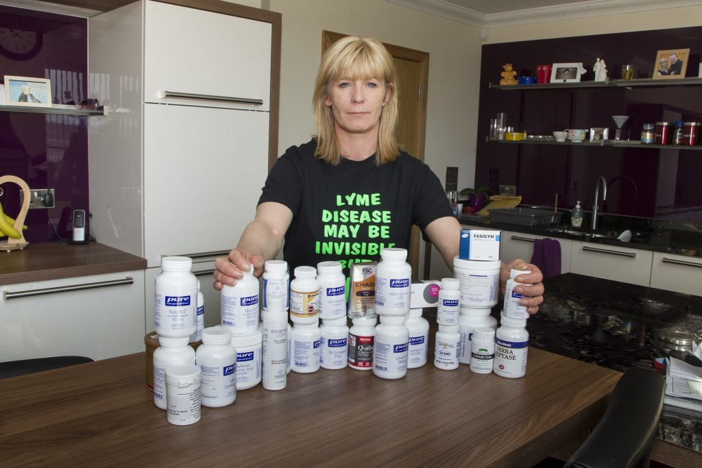 Lorraine Murray with a selection of the tablets she now takes to manage her condition.