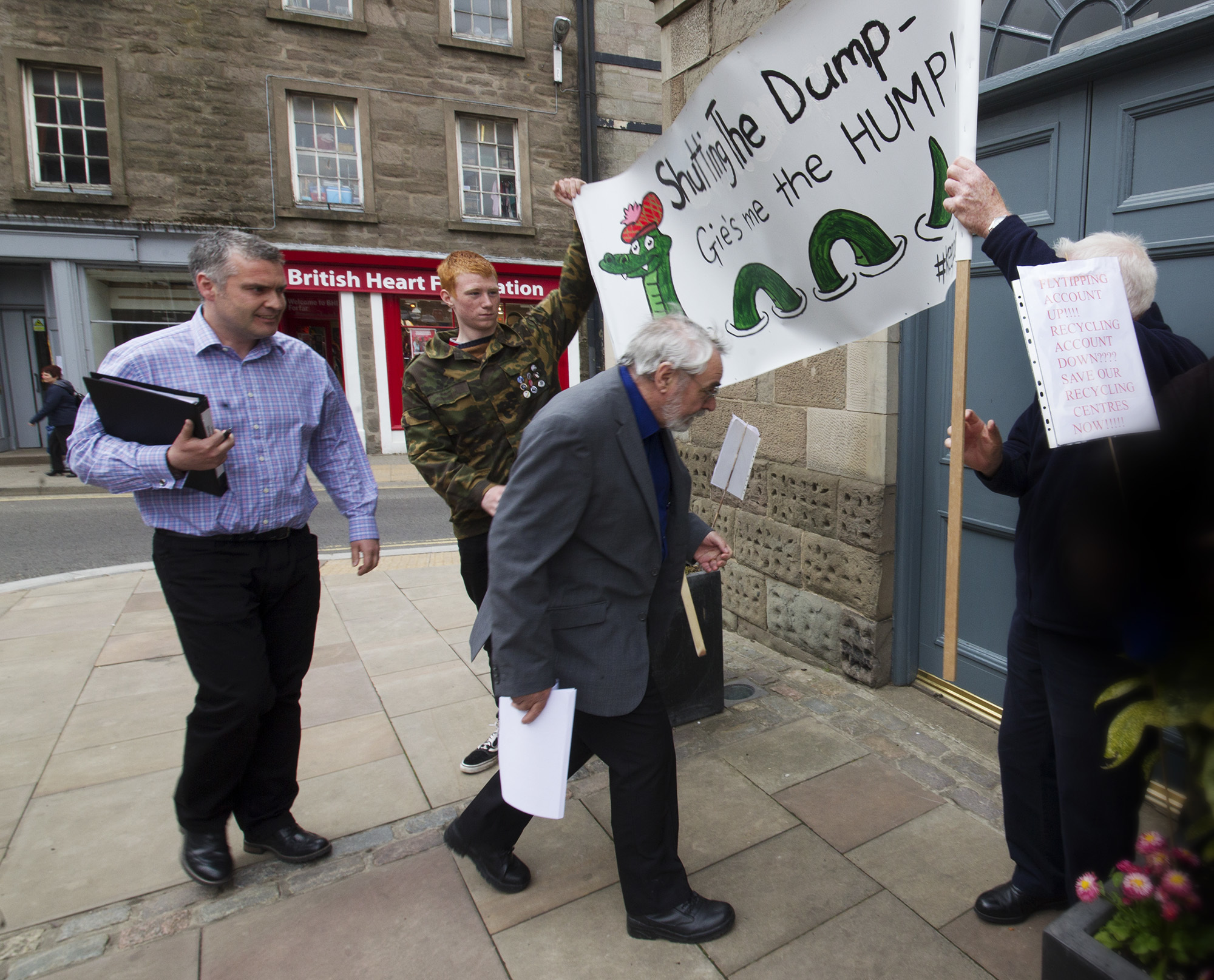 Protests took place at Town and County Hall over the planned recycling cuts.