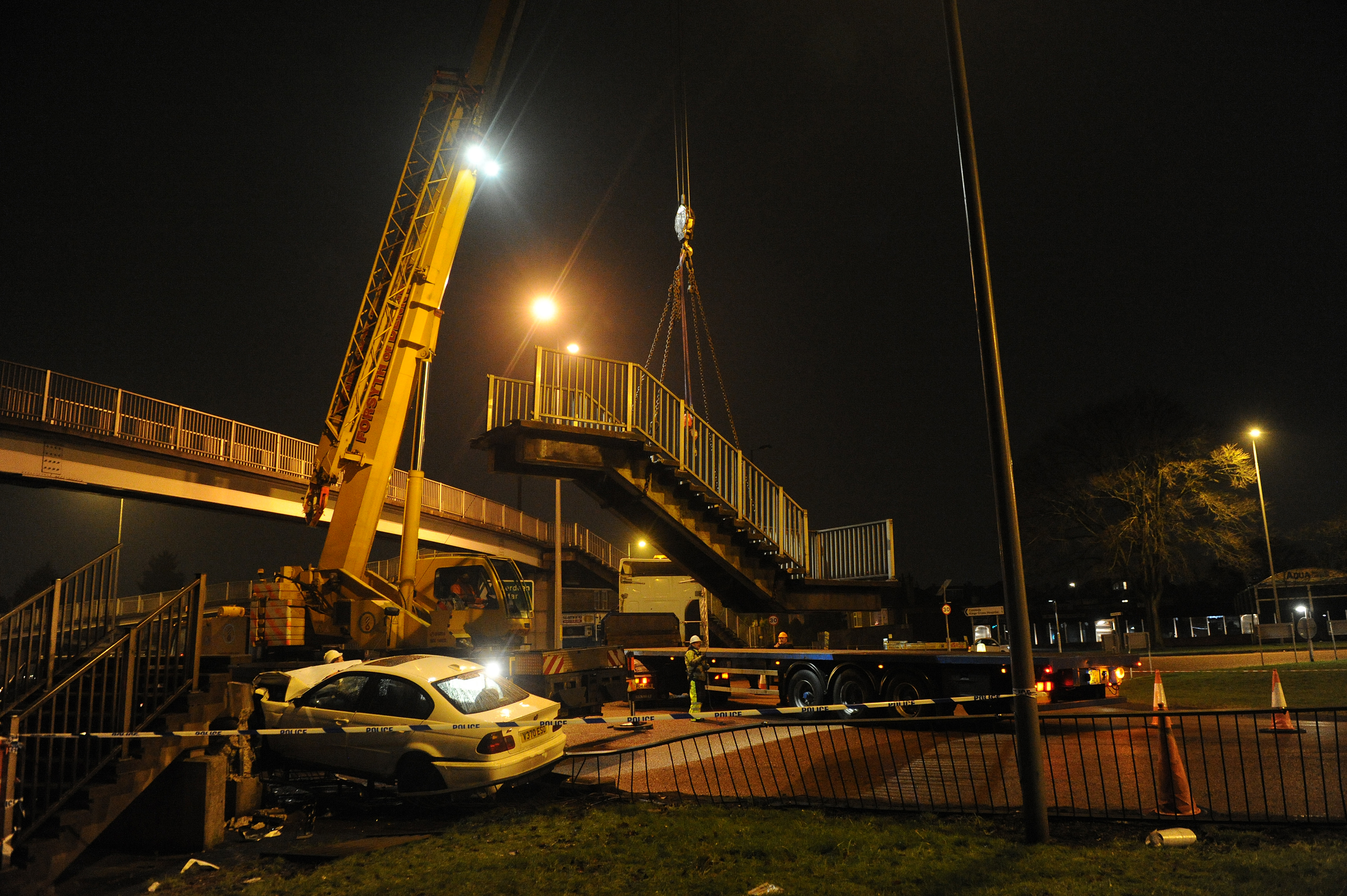 The footbridge was badly damaged when a high-powered BMW ploughed into it in January. The damaged section had to be craned away.