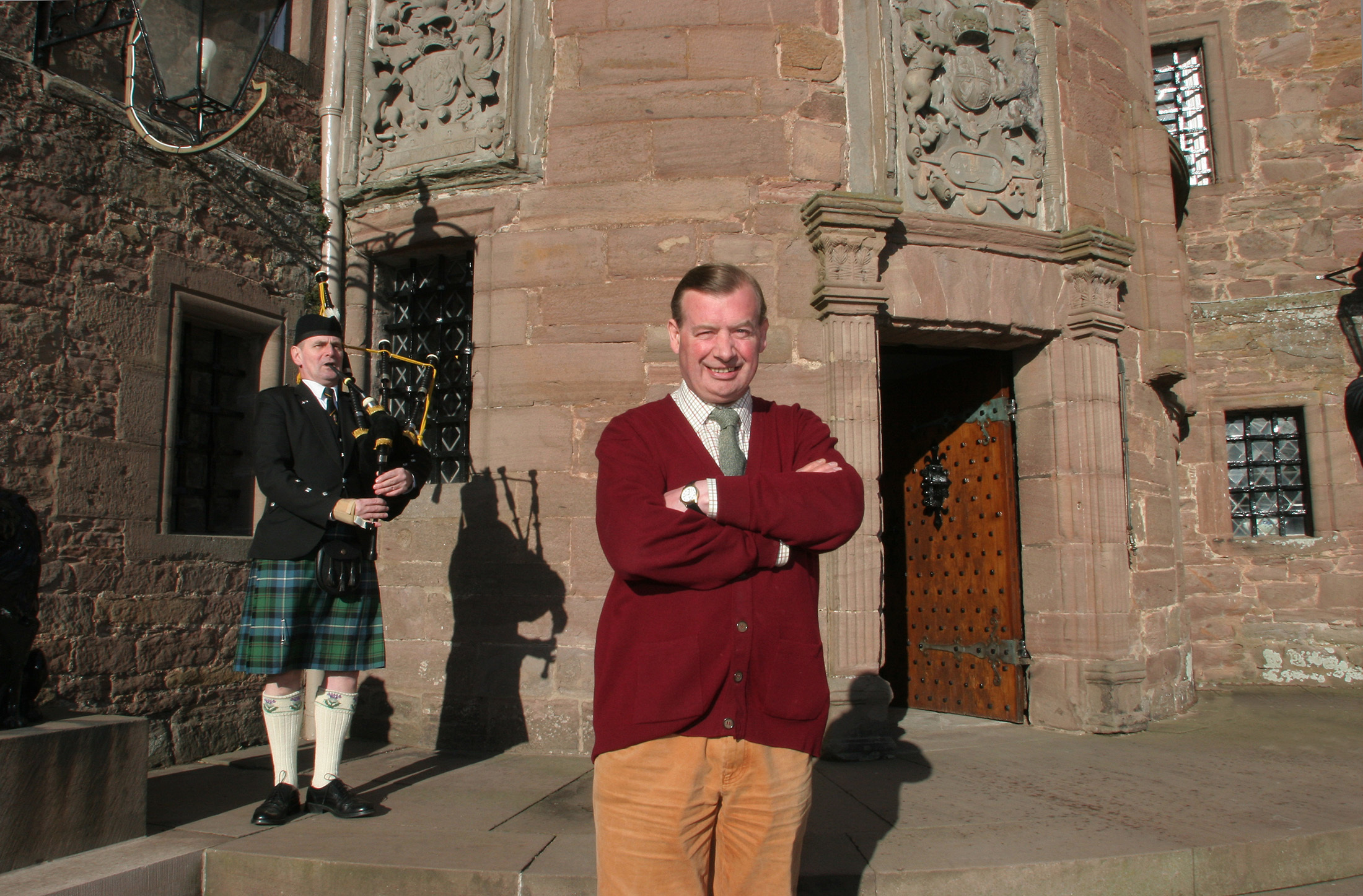 The 18th Earl of Strathmore and Kinghorne, Michael Fergus Bowes-Lyon with Forfar piper David Myles.