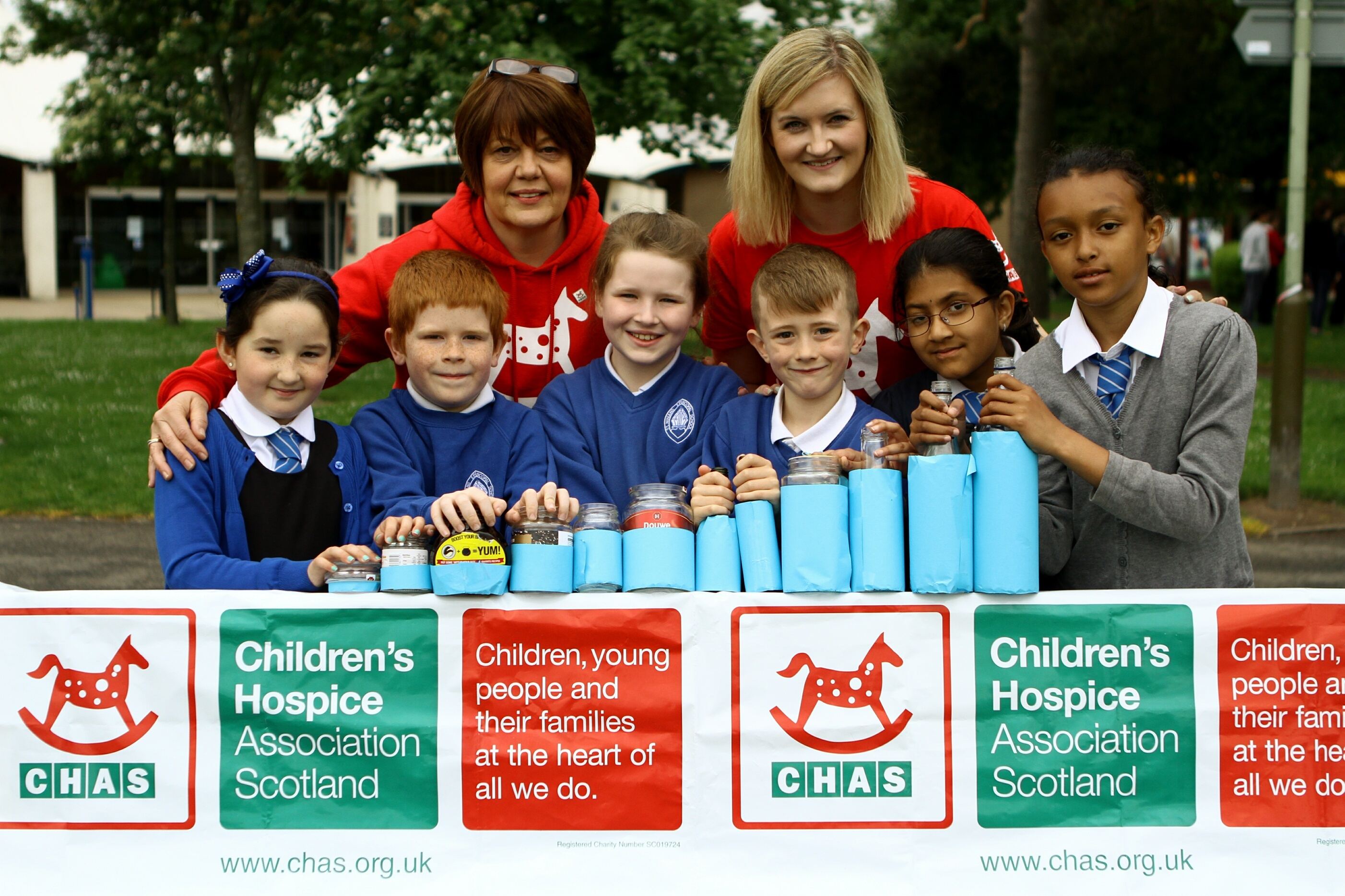 Primary 3/4 pupils from St. Ninian's Episcopal Primary School, Ryley Mitchell, Ethan Hutchison, Sophie Selby-Leslie, Andrew Milne, Sathu Enkahthi and Sarah Bozic with their 'bottle graph' and Alison Rennie and Sarah Dannfeld - community fundraisers with CHAS.