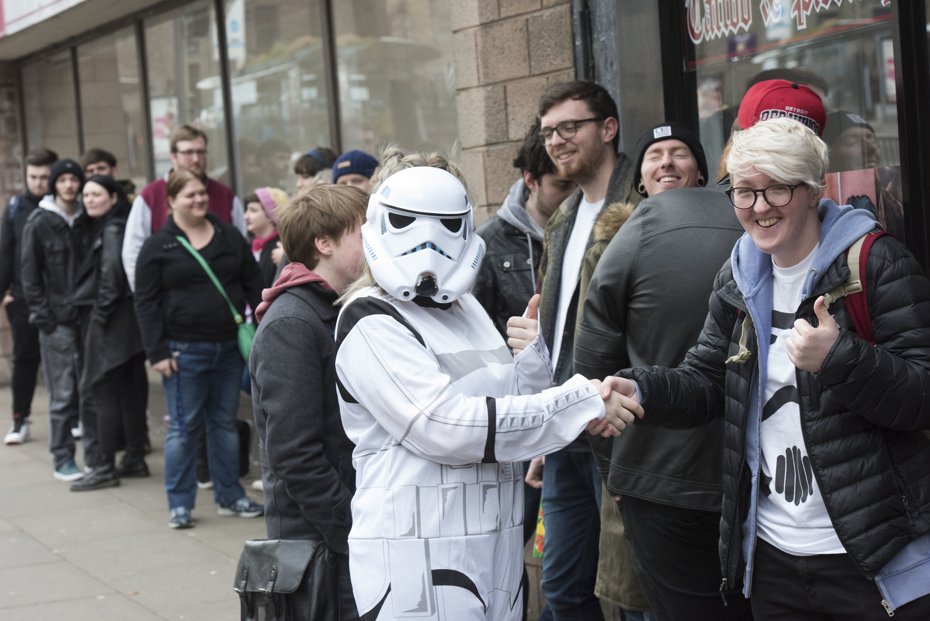 Fans gather outside Rock n Roll Tattoo and Piercing and are greeted by a stormtrooper.