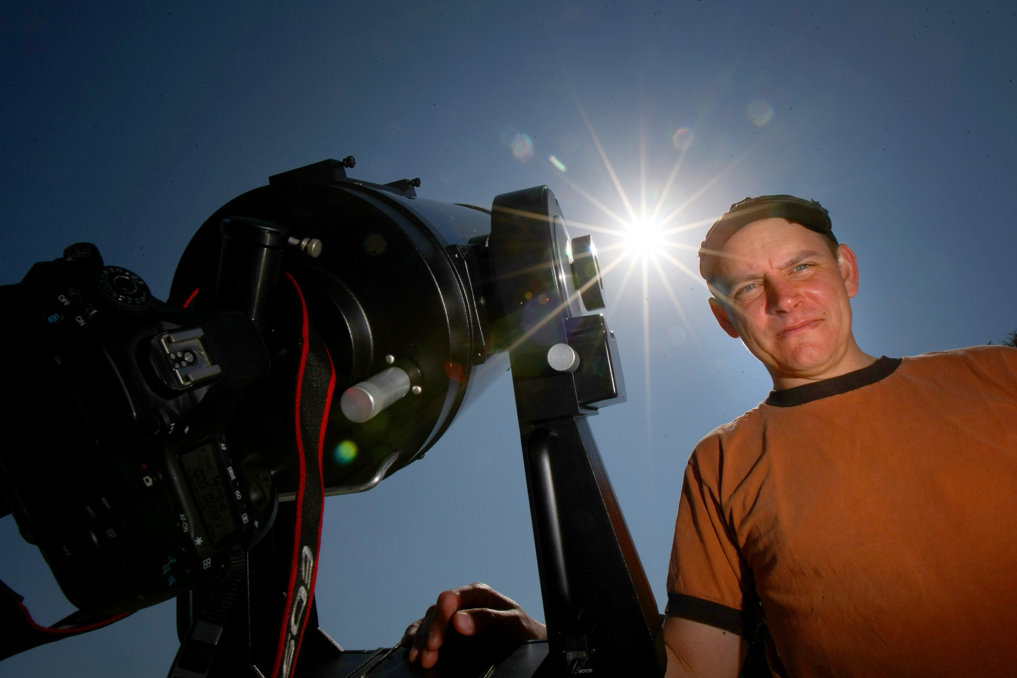 Aleks Scholz, Observatory Director looking at a screen attached to a special telescope showing the transit
