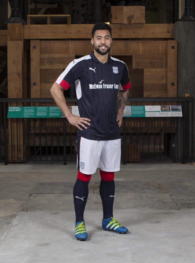 DundeeÕs Kane Hemmings models the club's 2016-17 home kit