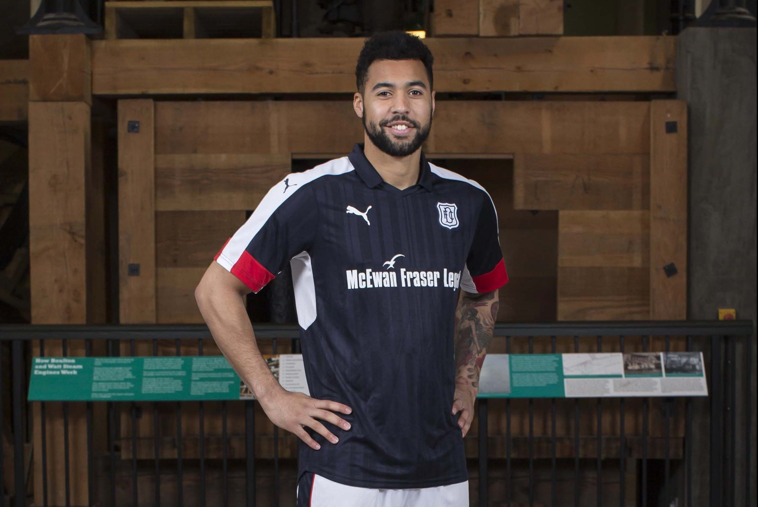 Dundee's Kane Hemmings models the club's  new home kit.