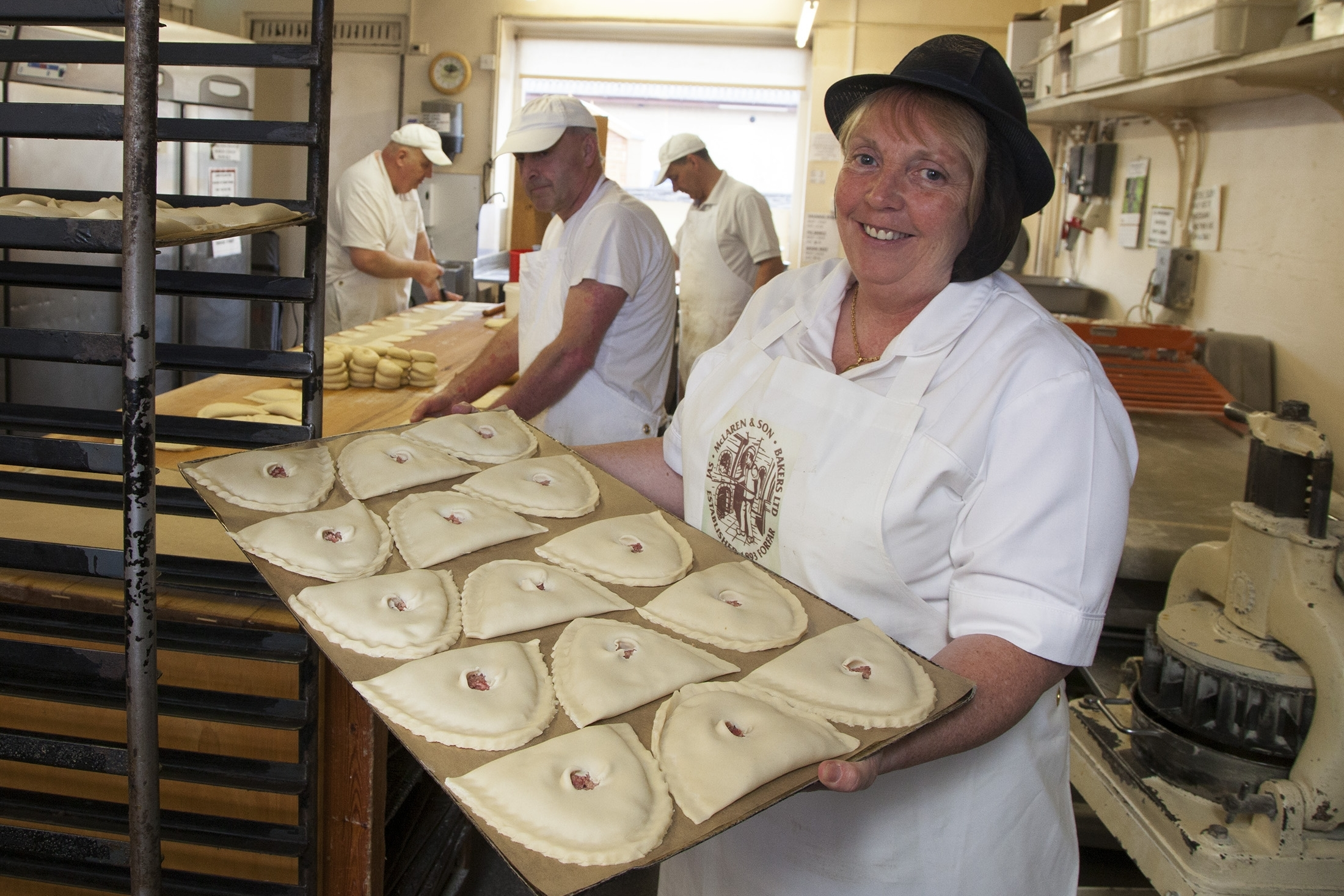 Karen Murray prepares to put a batch of Forfar Bridies in the oven at  McLaren's.